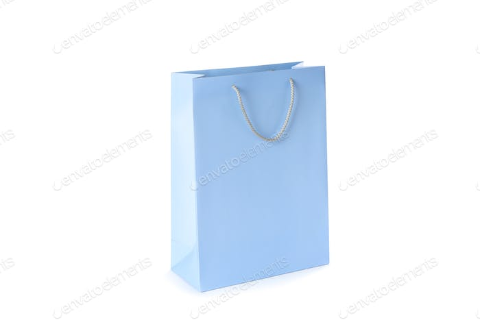 Blue paper bag isolated on white background
