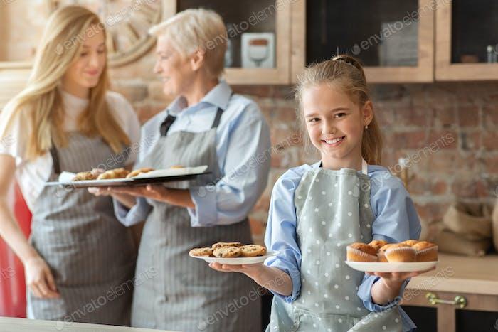 Happy girl demonstrating freshly baked home pastry