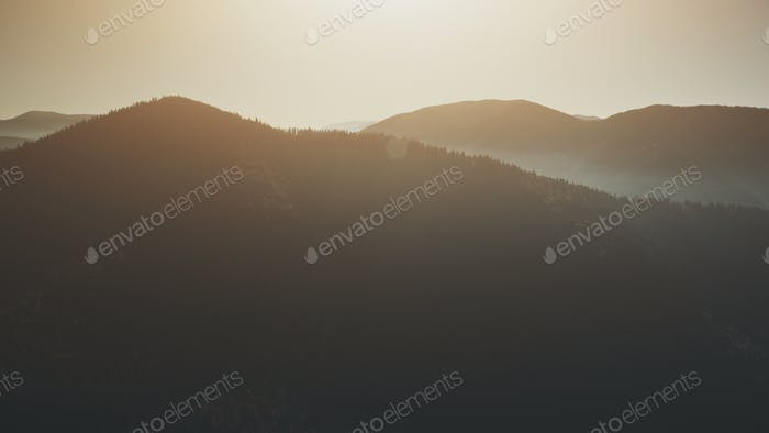 High mountain peak slope sunrise sight aerial view