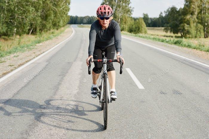 Woman making downhill with mountain bike