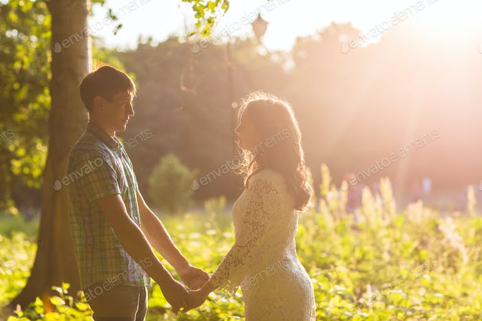 Romantic young love couple in summer nature