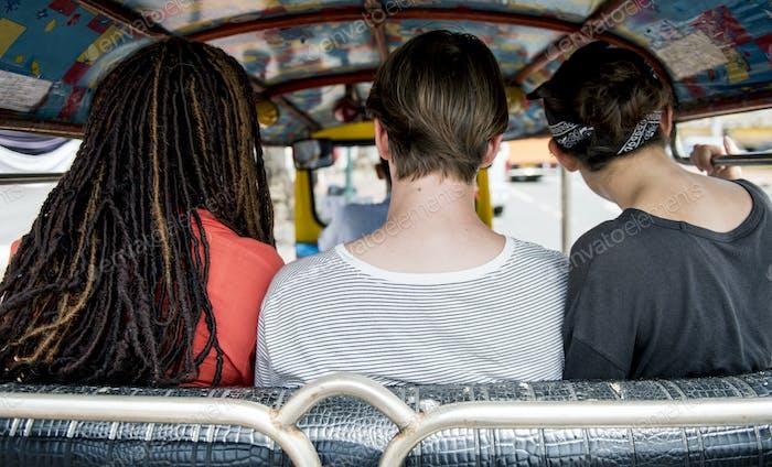 Group of tourists enjoying a tuk tuk ride