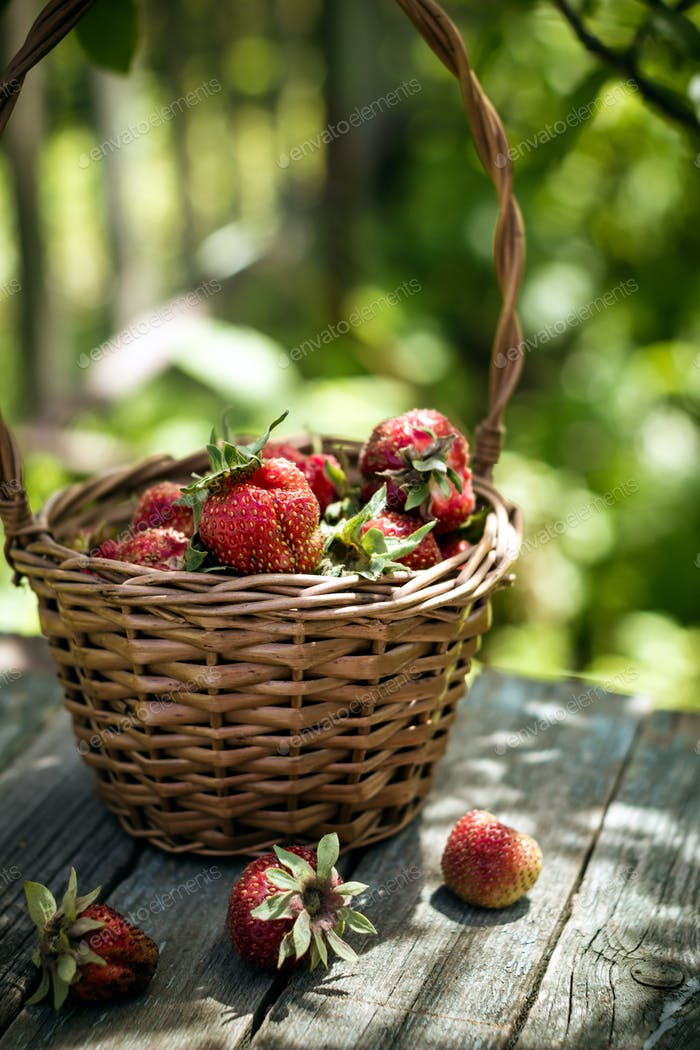 Basket of strawberry on rustic table