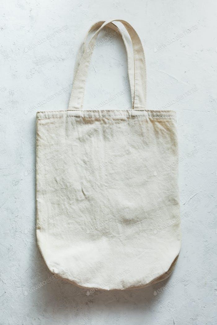 Modern canvas shopping bag on light background