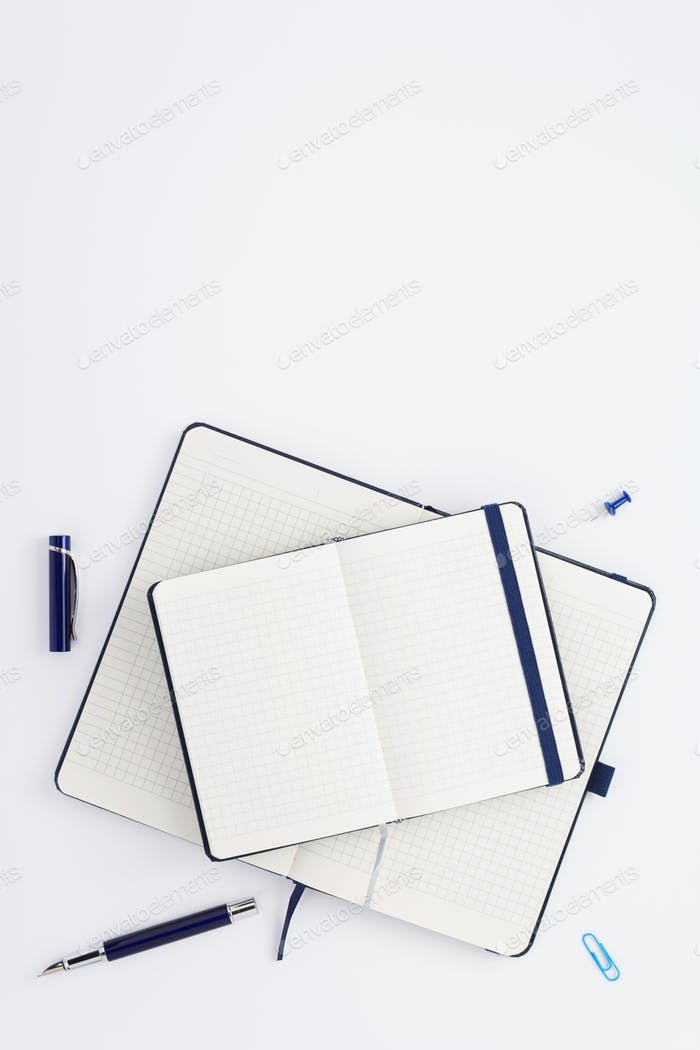 notebook and stationary at white background