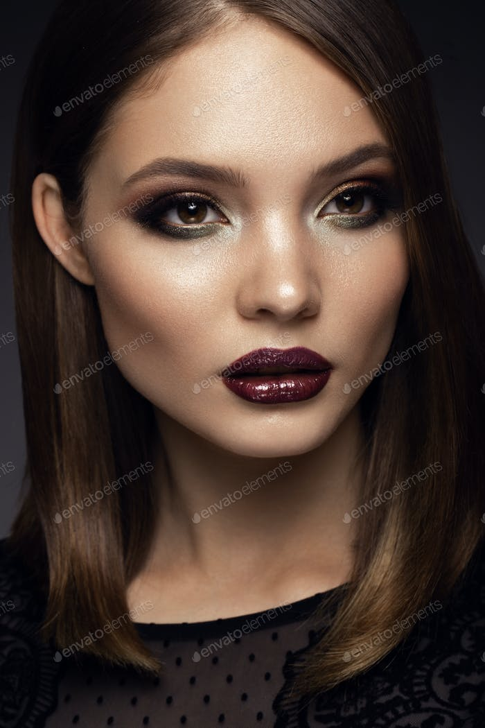 Beautyful girl with bright make up. Cherry lips