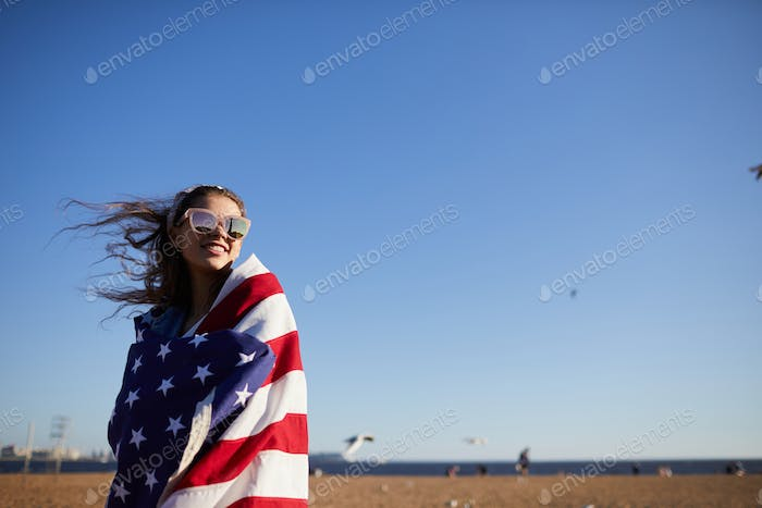 Jolly woman wrapped in national flag