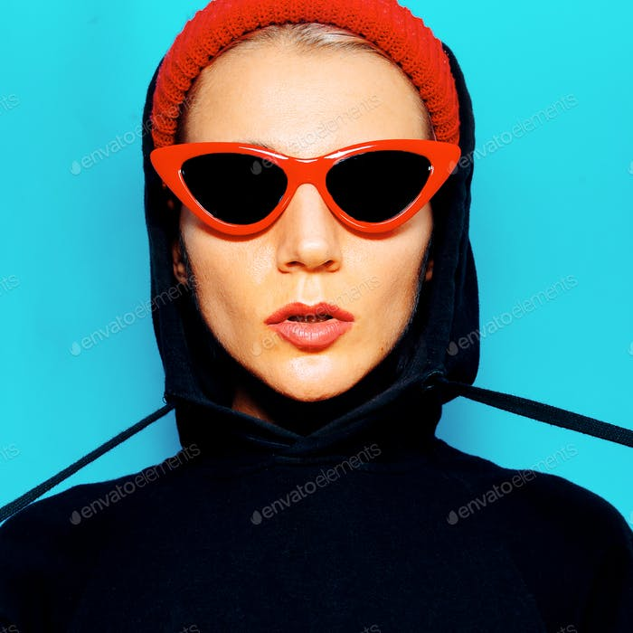 Tomboy Model in fashion sunglasses and beanie. Urban Style