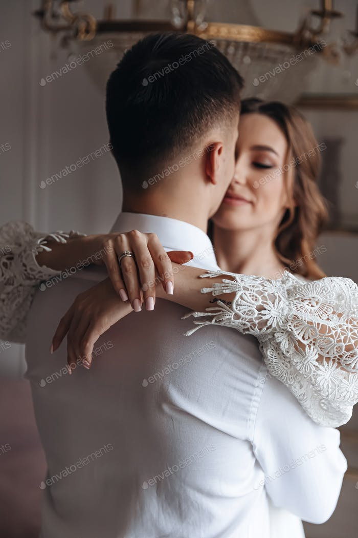Portrait of a young bride and groom in an embrace.