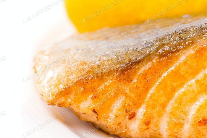 Grilled salmon fillet with lemon.