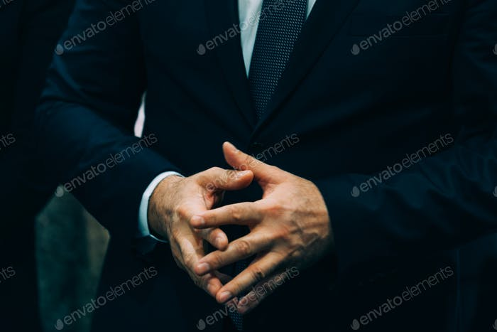 Businessman gesturing with hands