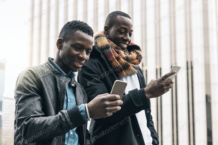 Business men using mobile in the Street.