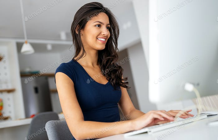 Business woman working on laptop from home office