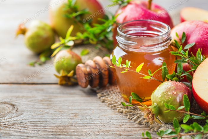 Rosh Hashana, jewish new year holiday concept, honey, apple, pomegranate
