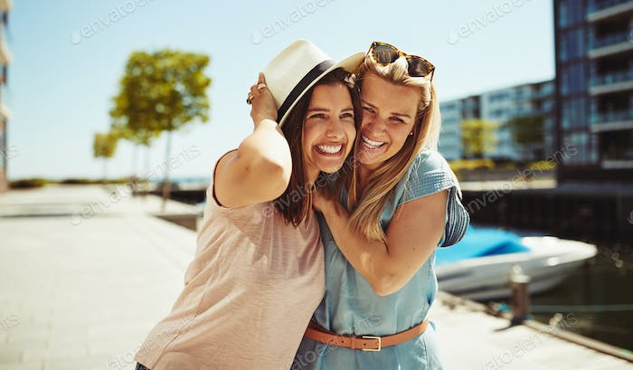 Laughing young girlfriends having a good time together in summer