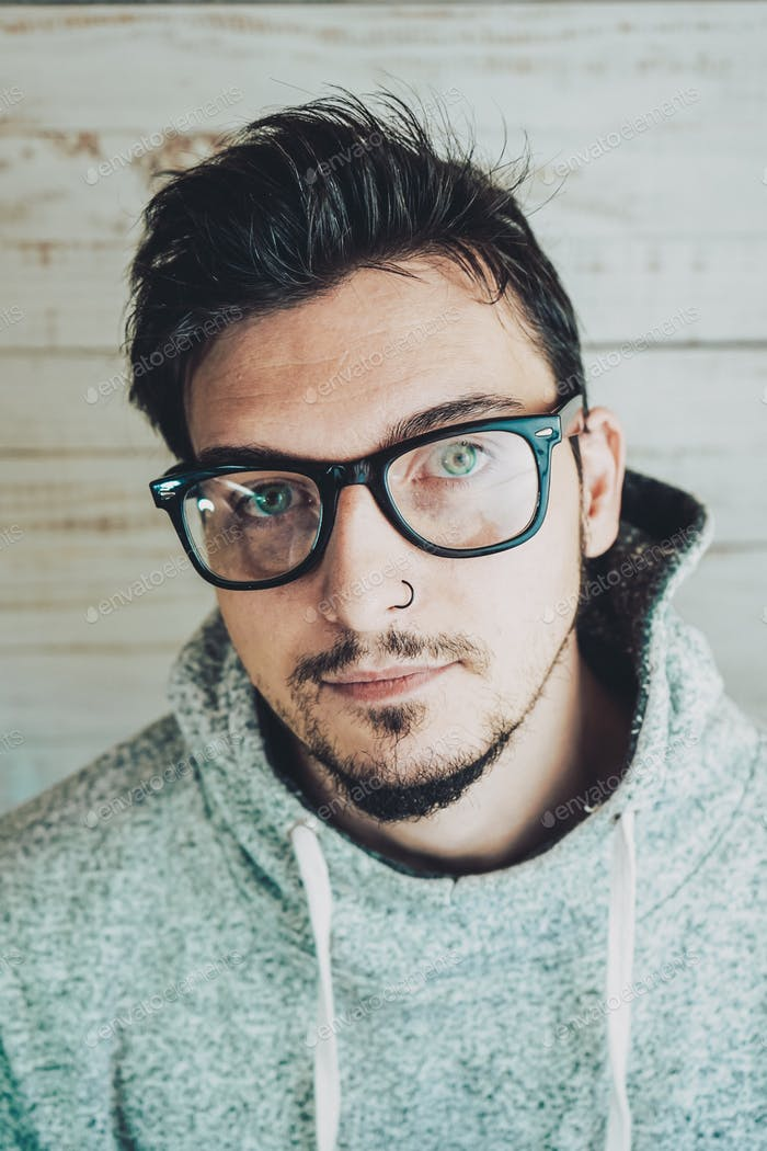 Attractive young man wearing glasses