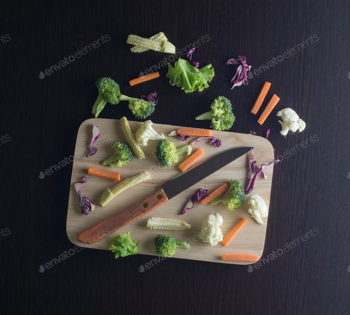 Mixed Vegetables have a carrots cabbage, lettuce on cutting boards with knife - clean food concept