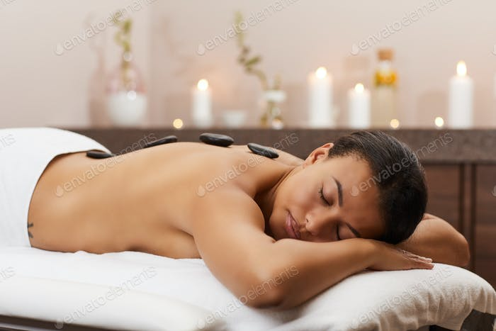 Beautiful Woman Enjoying Stone Therapy