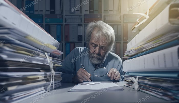 Senior researcher using a magnifier