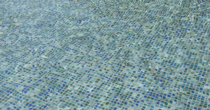 Beautiful refreshing blue swimming pool water