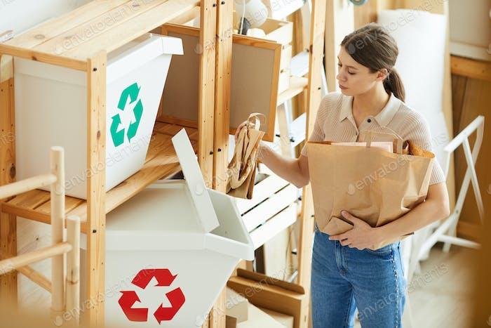 Woman sorting paper bags