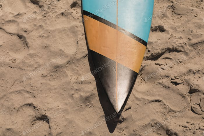 Close-up of surfboard on beach in the sunshine
