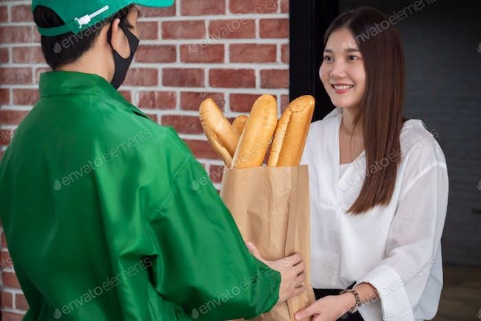 Happy woman recieving food from food deliveryman