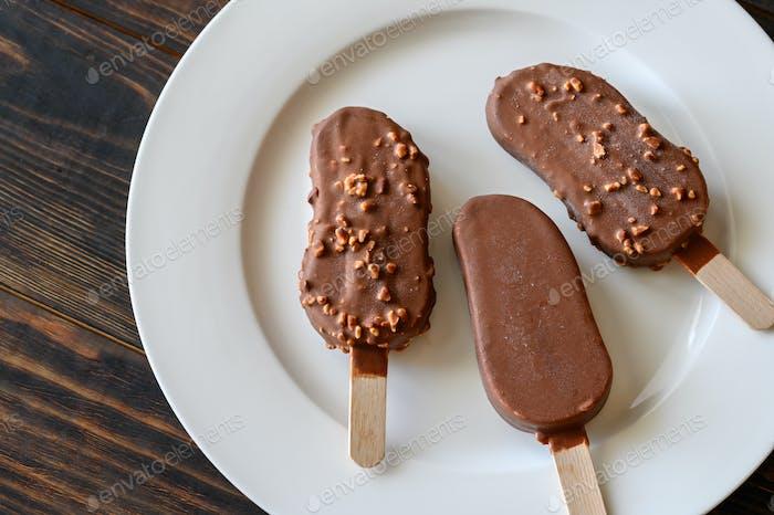 Chocolate-covered vanilla ice cream bars