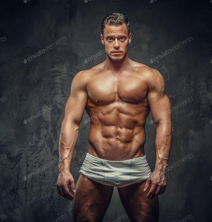 Muscular man in white panties