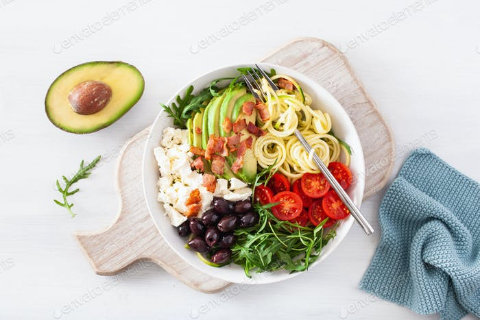 ketogenic lunch bowl: spiralized courgette with avocado, tomato, feta cheese, olives, bacon