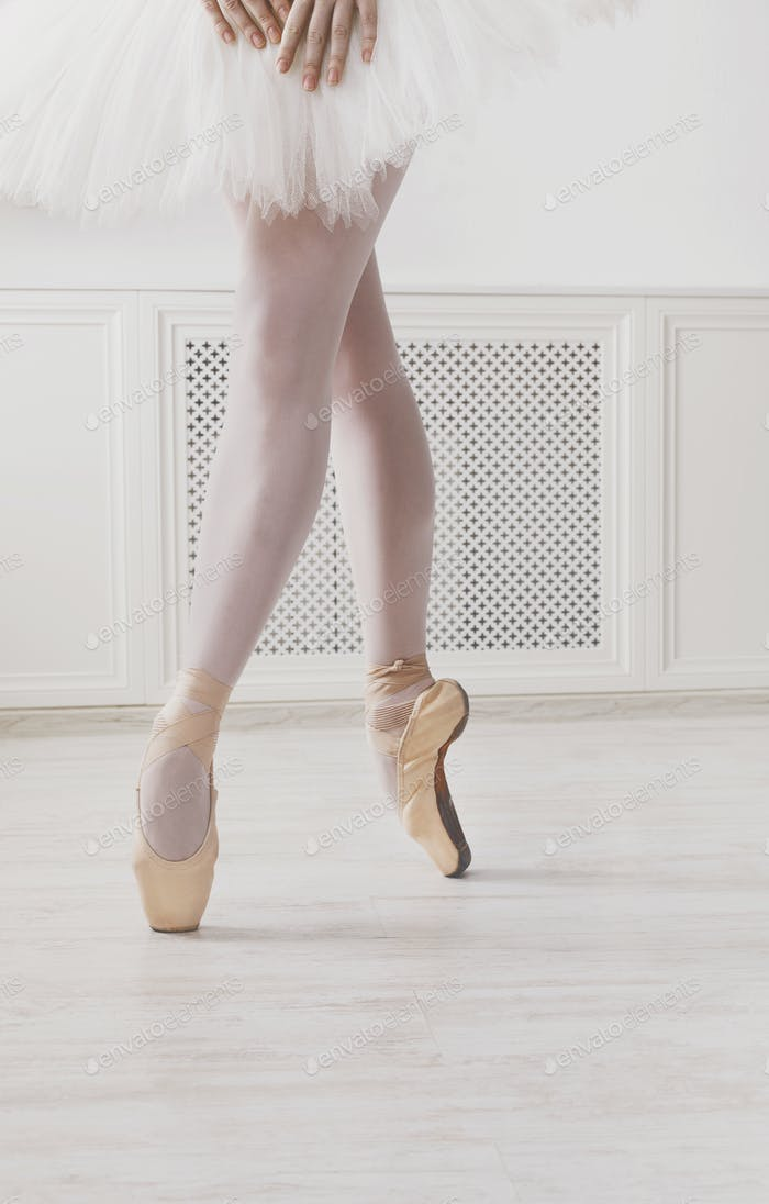 Closeup legs of young ballerina in pointe shoes, ballet practice