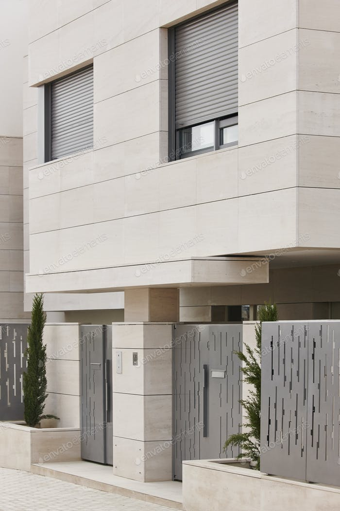 Modern residential building entrance. Estate property. Marble stone. Construction. Vertical