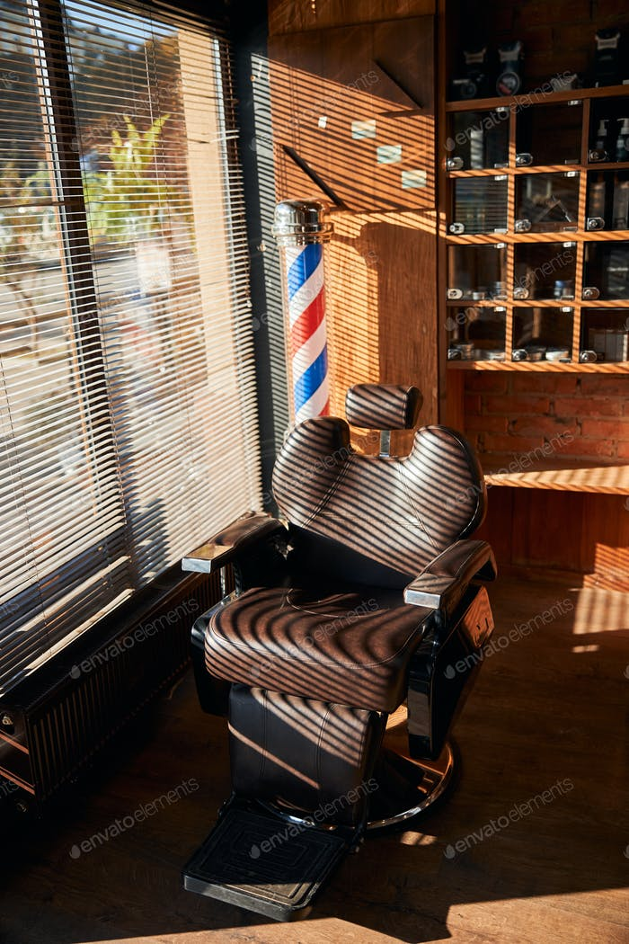 Interior of barbershop with professional barber chair