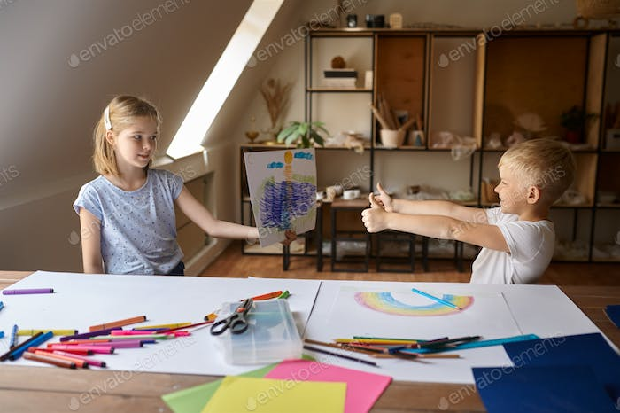 Two children at the table in drawing class