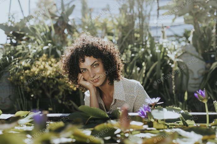 Beautiful woman by a lotus pond
