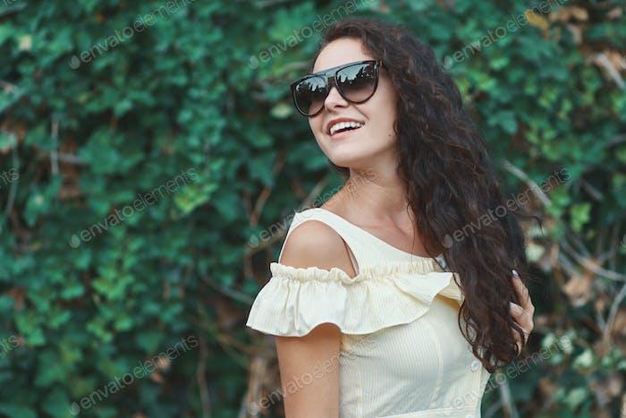 Feminine fresh sunglasses model with shiny white smile