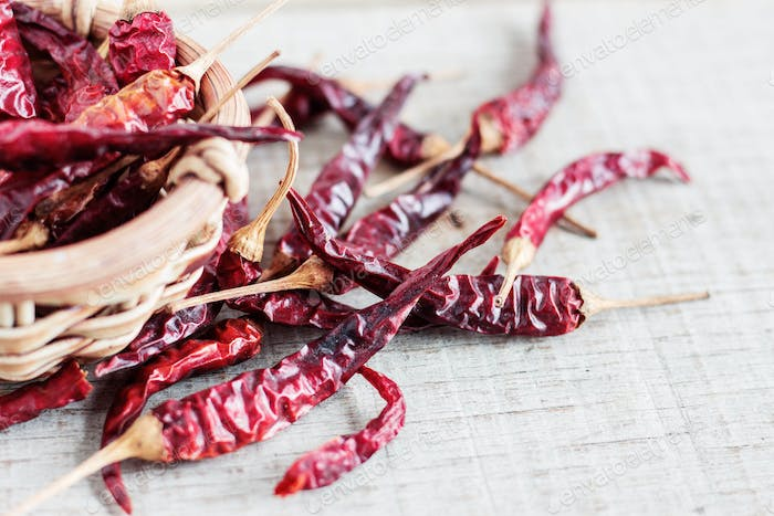 dried chilli on wooden floor