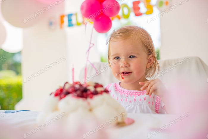 Cute Little Girl Eating Birthday Cake