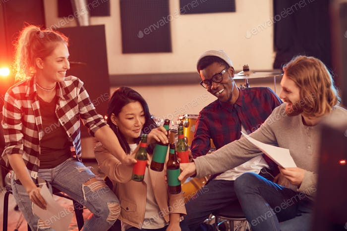 Group of Young People Drinking Beer in Music Studio