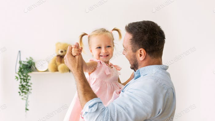 Portrait of daughter dancing with her dad