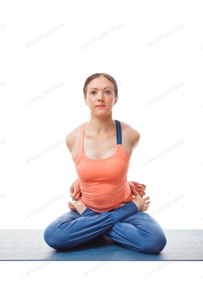 Sporty fit woman doing Ashtanga Vinyasa yoga asana Baddha Padma