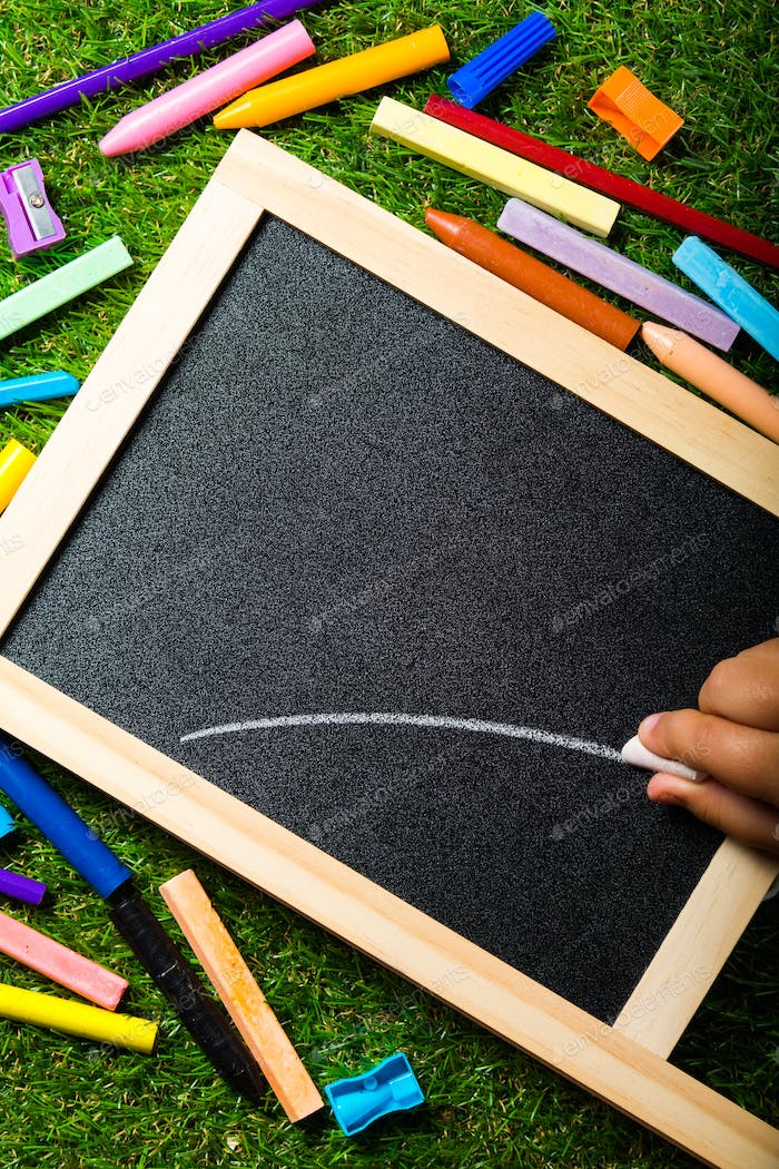 Top view of mini blackboard and copy space for your text. Concept back to school