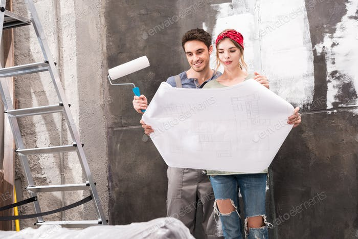 young couple looking at schemes while renovation home