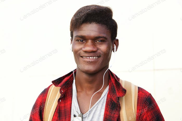 Close up stylish young man smiling against white background