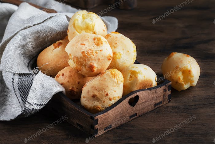 Golden Cheese buns in wooden tray