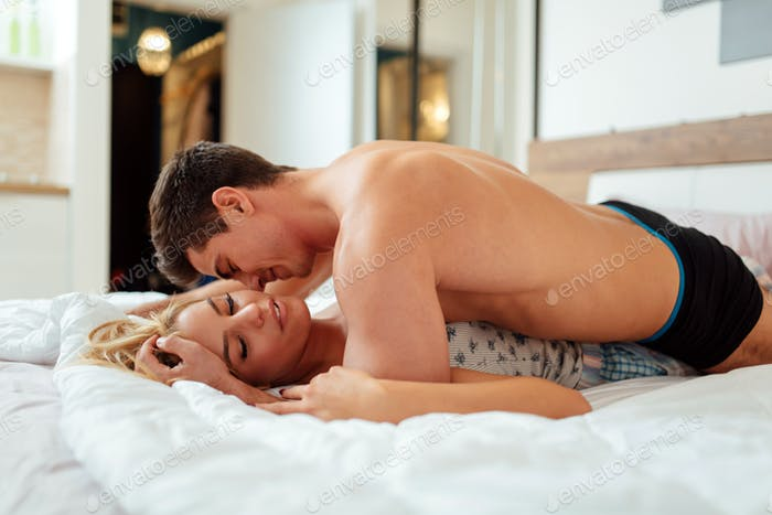 Sensual foreplay in bed