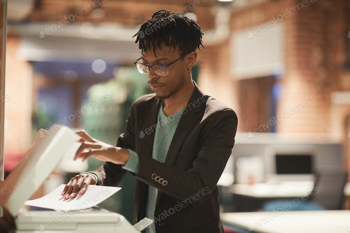 Businessman making a copy at office