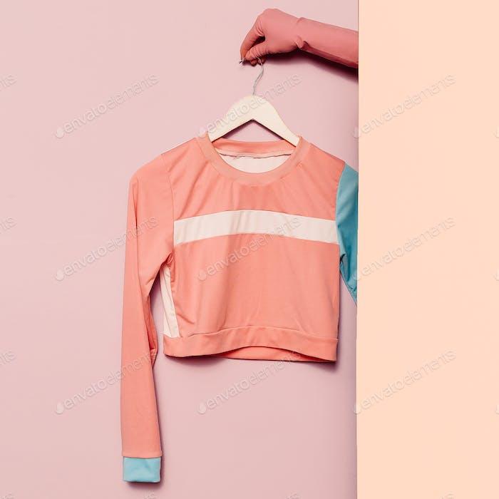 Stylish sportswear. Minimal fashion. Top stripe print on a hange