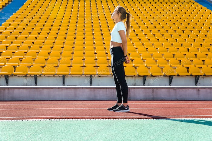Fitness woman resting on the stadium