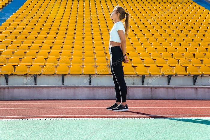 Fitness woman resting on the stadium